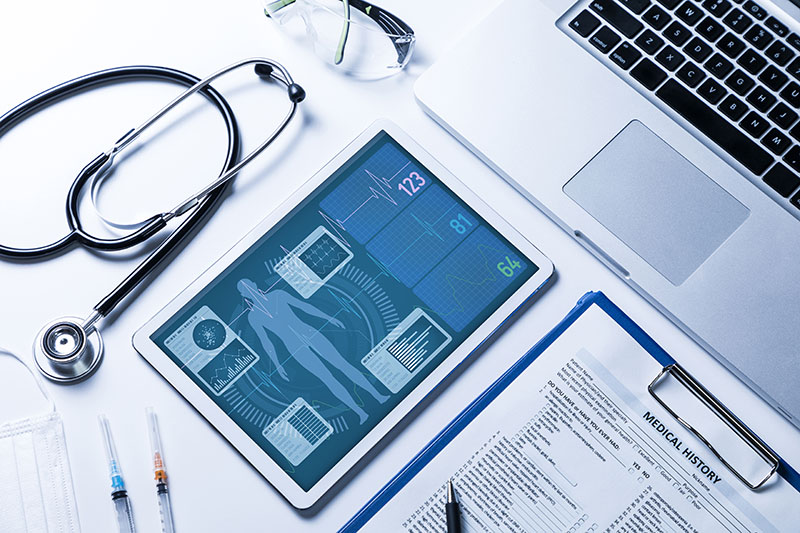Vital signs on tablet screen, medical technology concept