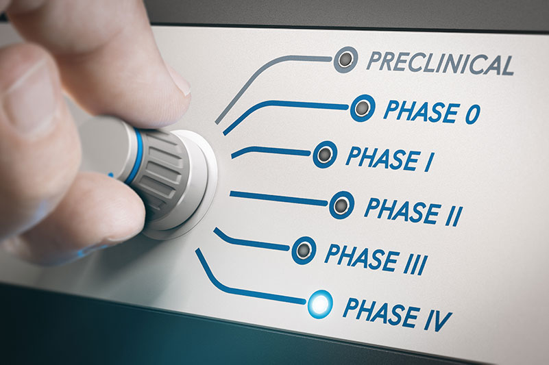Hand turning knob to select phases of clinical trial.